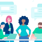 Live chat - flat design style illustration on white background. A colorful composition with international business team, employees discussing a project at the table, images of dialog boxes