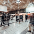 Motion blur of people walking in public exhibition hall. Business tradeshow, job fair, or stock market. Financial trade event, commercial activity, or shopping mall marketing advertisement concept